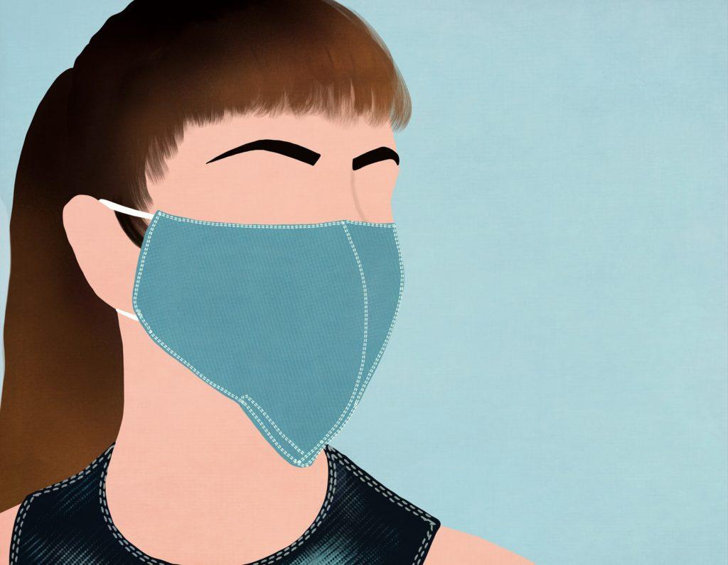 Muller con máscara protectora